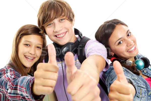 Cool cute tieners hoofdtelefoon tonen Stockfoto © pressmaster