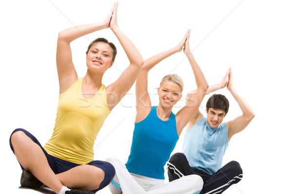 Jóga fotó meditál csoport ül karok a magasban Stock fotó © pressmaster