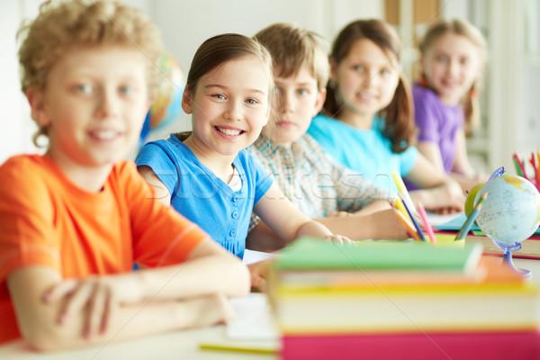 Osztálytársak lecke portré boldog szorgalmas néz Stock fotó © pressmaster