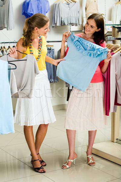 Choosing fashionable clothes Stock photo © pressmaster