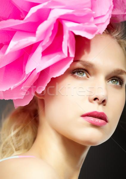 Káprázatos női nő rózsaszín virág portré rózsaszín Stock fotó © pressmaster