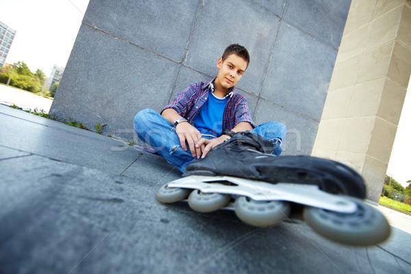 Stock photo: Lad on roller skates