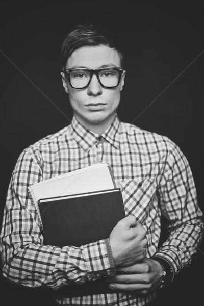 Chico libros retrato grave estudiante mirando Foto stock © pressmaster
