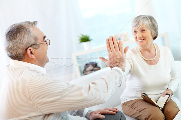 Portrait of a happy senior couple keeping their palms in touch Stock photo © pressmaster