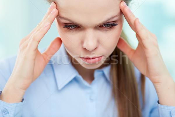 Retrato tenso mujer tocar cabeza cara Foto stock © pressmaster