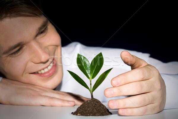 Planta imagem homem jovem negócio feliz Foto stock © pressmaster