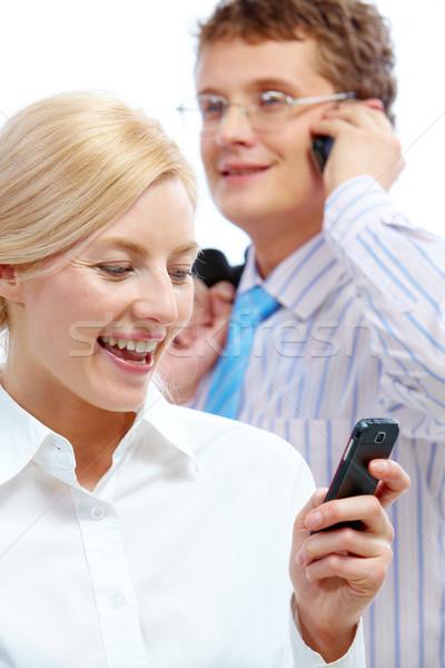 чтение sms изображение женщину призыв бизнесмен Сток-фото © pressmaster