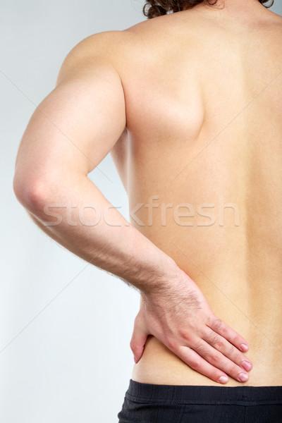 Ból powrót widok z tyłu młody człowiek dotknąć strony Zdjęcia stock © pressmaster