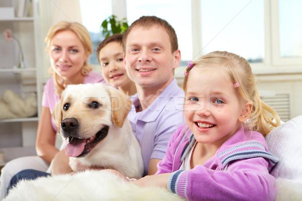 Boldog lánygyermek boldog család négy kutya ül Stock fotó © pressmaster