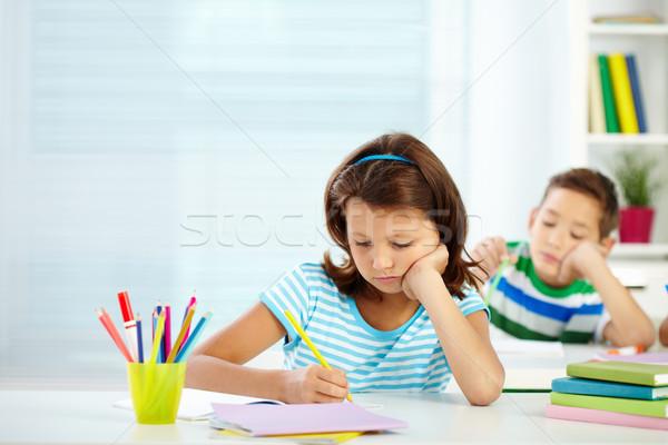 Schoolgirl at lesson Stock photo © pressmaster