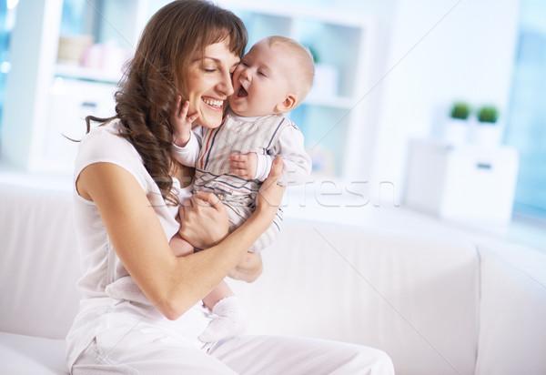 Gyermekgondozás portré boldog nő tart kicsi Stock fotó © pressmaster