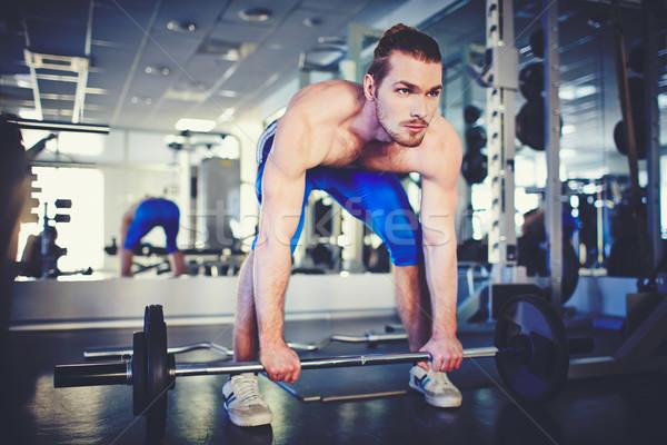 Weightlifter in gym Stock photo © pressmaster