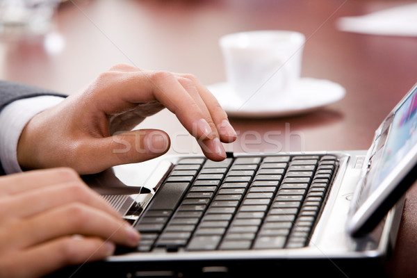 Hand above keyboard Stock photo © pressmaster