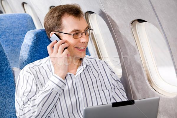 Iş adamı portre çağrı telefon uçak iş Stok fotoğraf © pressmaster