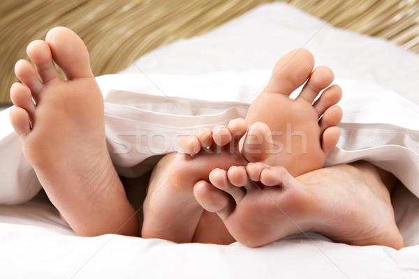Bose stopy obraz dwa mężczyzna kobiet Zdjęcia stock © pressmaster