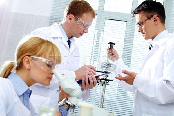 Foto stock: Trabalhando · mulher · médico · medicina · escrita · lab