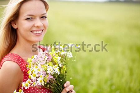 Female with bouquet Stock photo © pressmaster