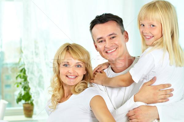 Családi portré derűs család három mosolyog kamera Stock fotó © pressmaster