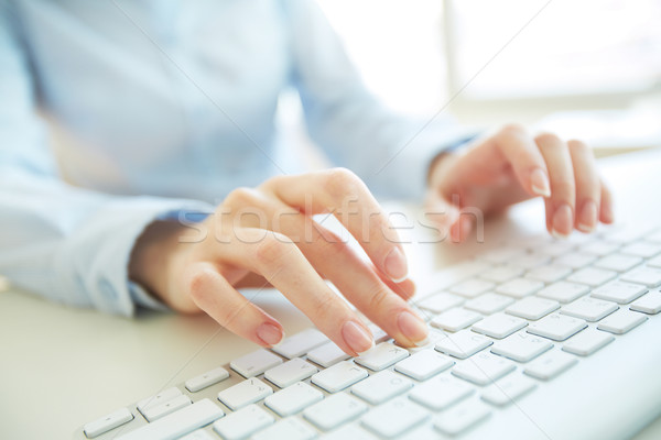 Stock photo: Typing worker