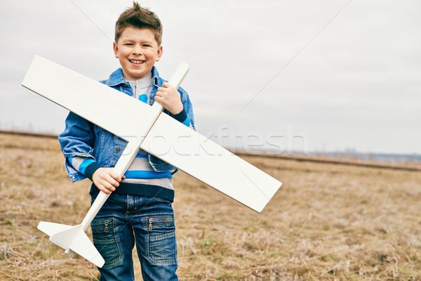 Boy with toy airplane Stock photo © pressmaster