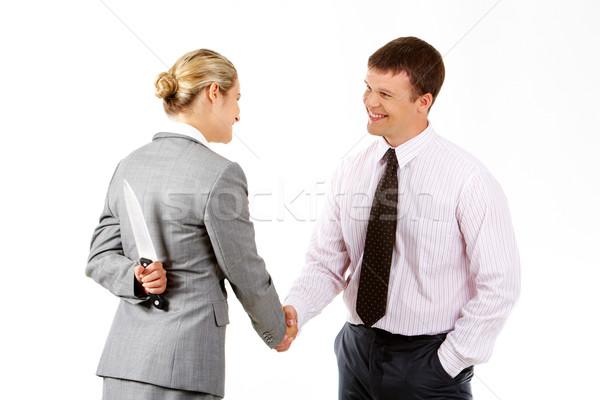 Perigoso aperto de mão imagem mulher de negócios faca acordo Foto stock © pressmaster