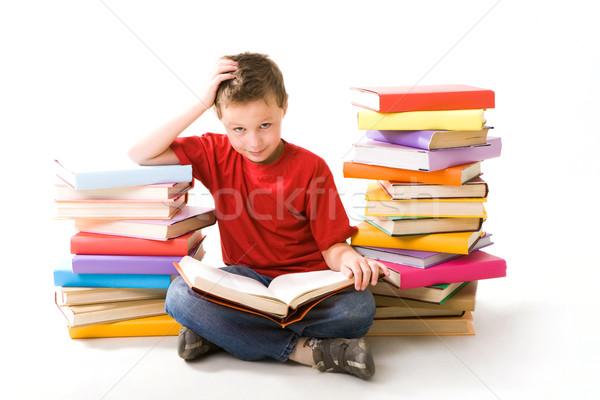 Fiatalos olvasó kép iskolás fiú ül kettő Stock fotó © pressmaster