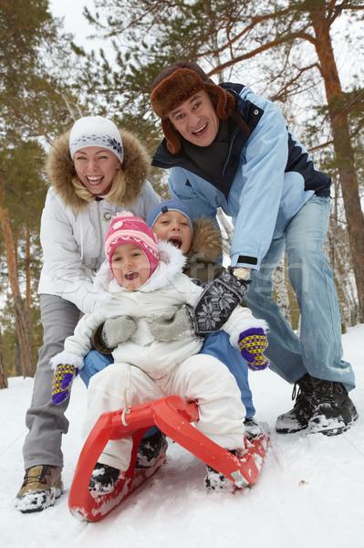 Family on sledge Stock photo © pressmaster