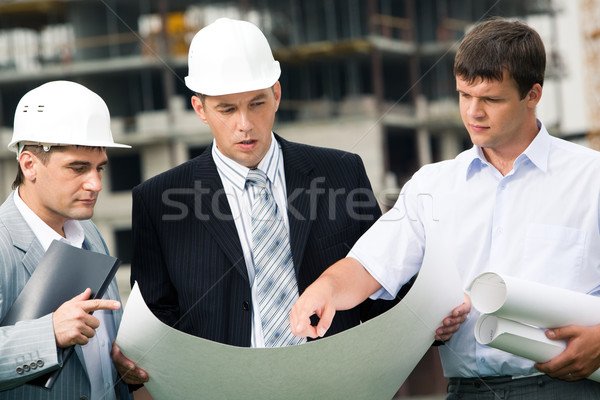 Magyarázat portré munkacsoport építők néz új Stock fotó © pressmaster