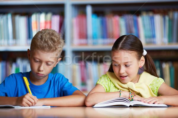 Classmates reading Stock photo © pressmaster