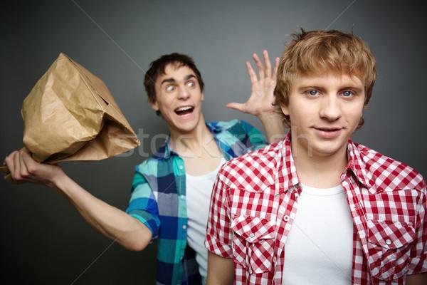 Boom crazy guy bereit Papiertüte hinter Stock foto © pressmaster