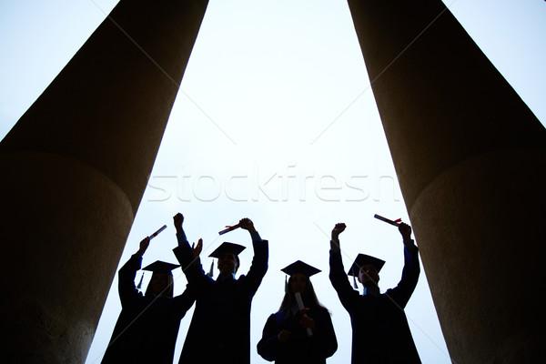 Koniec kolegium cztery absolwenci certyfikaty Zdjęcia stock © pressmaster