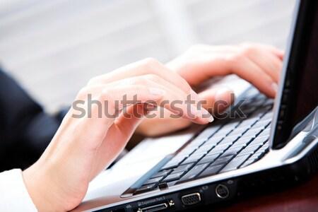 Creative изображение рук человека используя ноутбук бизнеса Сток-фото © pressmaster