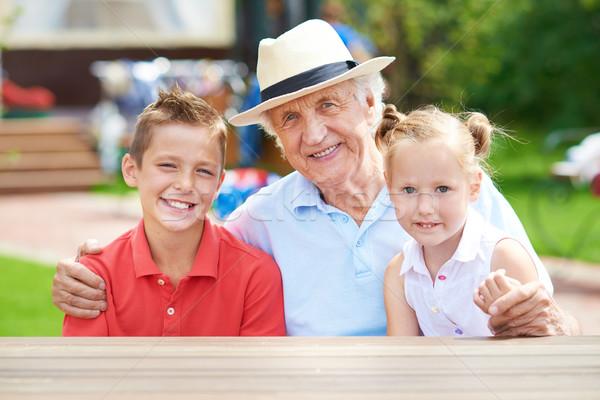 Man with grandchildren Stock photo © pressmaster