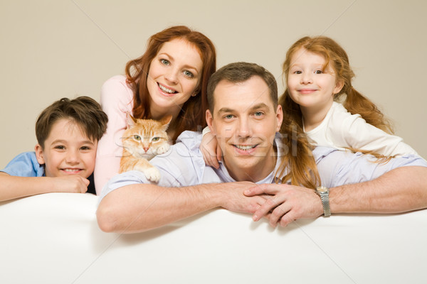 Сток-фото: Семейный · портрет · счастливым · пару · два · детей · улыбаясь