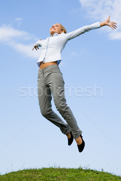 Excitação retrato feliz feminino saltando grama verde Foto stock © pressmaster