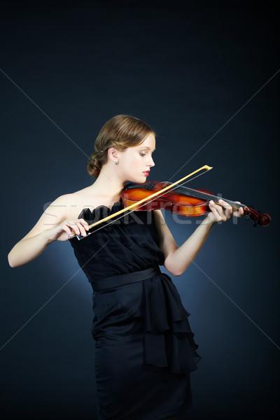 Hegedűművész portré fiatal női játszik hegedű Stock fotó © pressmaster