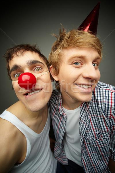 Caras palerma festa dois engraçado olhando Foto stock © pressmaster