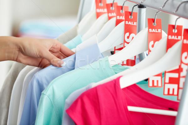 Looking through clothes Stock photo © pressmaster