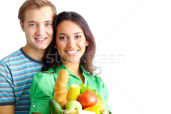 Sağlıklı mutlu çift sağlıklı beslenme bakıyor kamera Stok fotoğraf © pressmaster