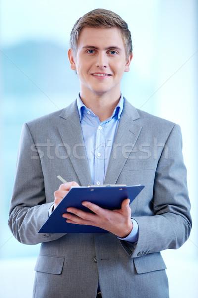 Businessman with clipboard Stock photo © pressmaster