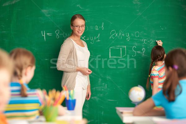 Сток-фото: учитель · доске · портрет · Smart · Постоянный · глядя