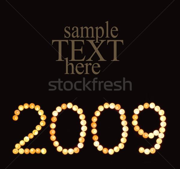 Szimbólum 2009 kép év szám tűz Stock fotó © pressmaster