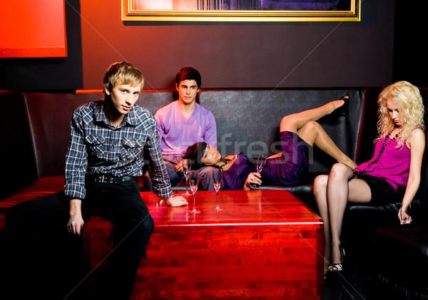 Parti portre grup gençler rahatlatıcı gece klübü Stok fotoğraf © pressmaster