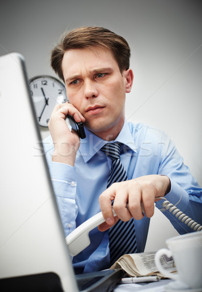 Trabalhar apressar retrato sério empresário olhando Foto stock © pressmaster