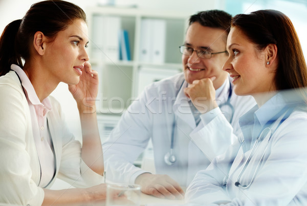 Physicians and patient Stock photo © pressmaster