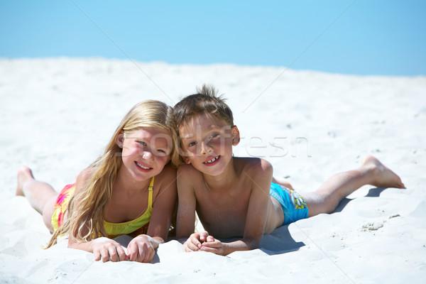 Testvérek fotó boldog homok nyári vakáció tengerpart Stock fotó © pressmaster