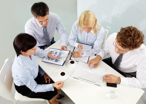 Gathered business people Stock photo © pressmaster