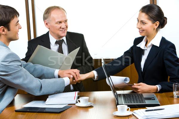 Union partenaires photo trois mains tenant bureau Photo stock © pressmaster
