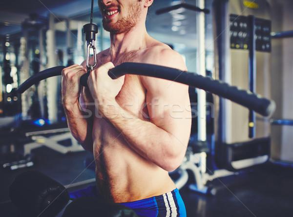 Wysiłek młody człowiek szkolenia specjalny sportu Zdjęcia stock © pressmaster