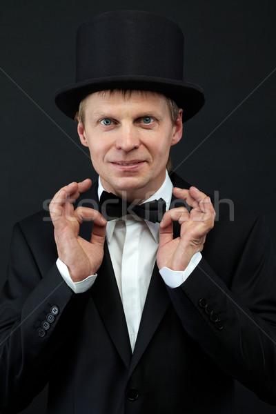 Férfi kép férfi bűvész csokornyakkendő néz Stock fotó © pressmaster